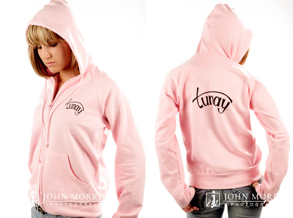 Fashion model, in studio, wearing a pink hoodie for a commercial apparel photo shoot in San Diego