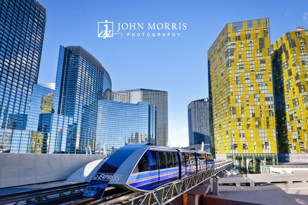 Architectural shot of the City Center in Las Vegas as a new monorail moves along the track during a commercial shoot.