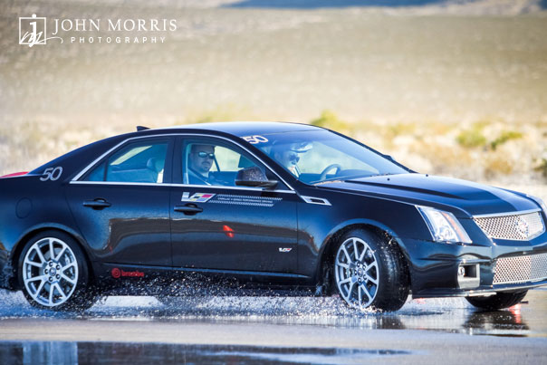 A new Cadillac handles the slippery road coarse test during a commercial shoot in Nevada.