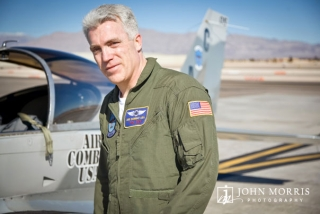 A pilot for Air Combat USA poses for the camera during a commercial shoot.