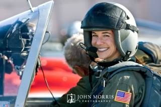 A female pilot smiles in anticipation of her first training flight.