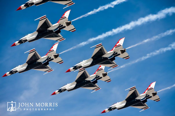 The US Air Force Thunderbirds fly in tight formation against a deep blue sky during a Nascar event in Las Vegas.