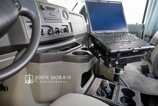 Interior product shot from inside an automobile of a laptop support system.
