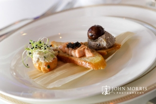Beautiful presentation and styling of Hors d'oeuvre's on a white table setting for a food photography shoot.