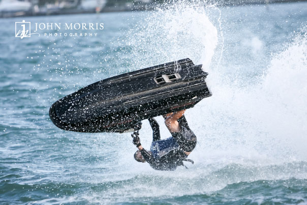 Professional Jet Ski rider performs a flip during a commercial photo shoot.