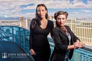 Poker players Amanda Musumeci and Evelyn Ng pose for a dramatic shot high above the Las Vegas strip during a commercial, lifestyle photo shoot.