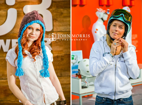 Two girls pose for the camera in winter fashion during a lifestyle shoot inside exhibit booths at a trade show event.