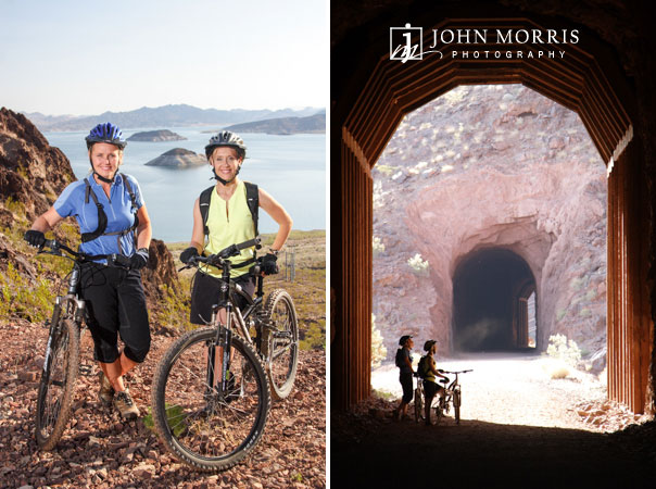 Two women bloggers posing next to mountain bikes and silhoutted at the entrance of an old railroad tunnel during a lifestyle photo shoot.