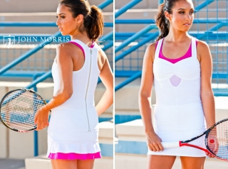 Fashion model poses on a tennis court, holding a tennis racket and wearing tennis apparel during a commercial, fashion shoot.