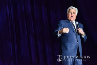 An animated Jay Leno, delivers one liners during on stage during a keynote speech.