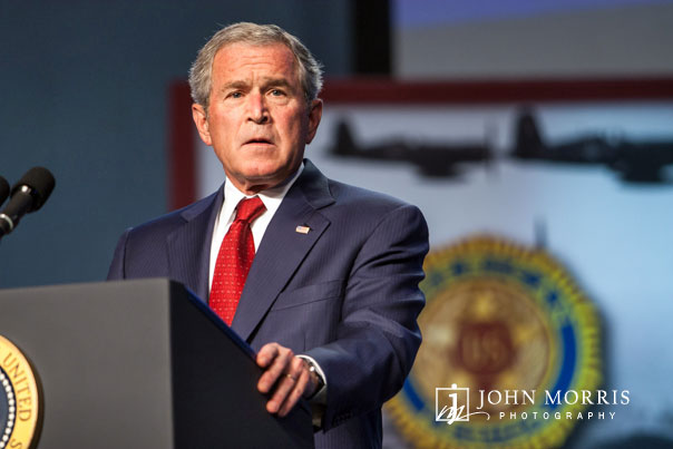 President George Bush speaks during a corporate event.