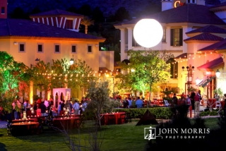 Gold cafe lights and a luminescent globe give an upscale fun feel to this outdoor networking event.