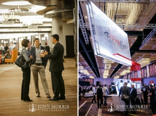 Attendees in Business attire networking in a commons area and spending time at a trade show booth.