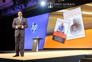 "Chris Gardner, author of the book, ""The Pursuit of Happiness"", gives a keynote speech during a conference."