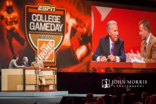 The crew of College Gameday, Lee Corso, Rece Davis, and Kirk Herbstreit reenact their popular presentation during a corporate event.