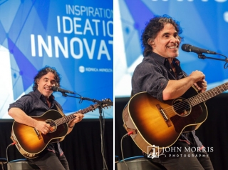 John Oates smiling, sharing stories and playing guitar for a private event in Aspen, CO.
