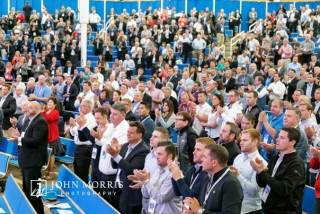 Standing ovation from a crowd of attendees at the Aspen Institute during a keynote speech.