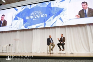 Peyton Manning on stage during a presentation in the Aspen Institute Music Hall during a corporate event.