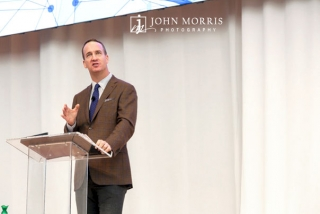 Peyton Manning making a point on stage during a talk for a corporate event at the Aspen Institute.