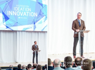 Peyton Manning, on stage, giving a keynote speech to a crowd of corporate event attendees at the Aspen Institute.