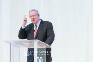 Steve Forbes making a point while speaking from a podium on stage during conference at the Aspen Institute in Aspen CO.