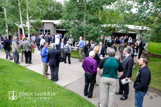 Large crowd of professionals enjoying an outdoor networking event at the Aspen Institute in Aspen, CO.