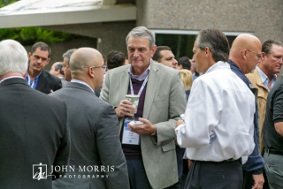Attendees in business attire sharing ideas at an outdoor networking event in Aspen, CO.