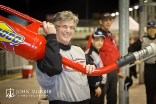Happy attendee posing with a racing gas can at the Richard Petty Driving Experience in Las Vegas.