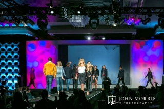 Full stage of fashion models on the catwalk during the final walk for a apparel company.
