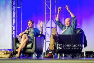 Animated speakers James Carville and Mary Matalin seated on stage, during a keynote.