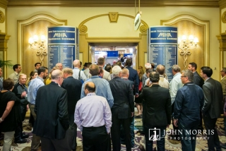Large crowd packing into a trade show during a conference at the Belagio in Las Vegas