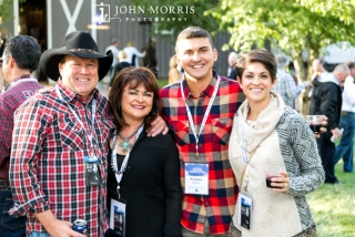 Executive and his family smiling for the camera during an outdoor networking event
