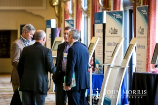 Four attendees sharing information during a trade show networking event