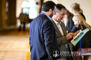 Two professionals sharing ideas during a conference networking event