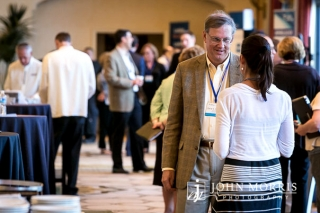Two attendees sharing ideas during a Corporate Event networking session