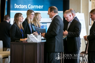 Excited, professional attendees registering for a medical conference