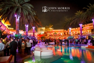 Large convention crowd enjoying poolside networking party at the Encore Beach club in Las Vegas