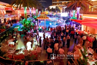 Large crowd of attendees enjoying an after hours networking party at the Encore Beach Club in Las Vegas