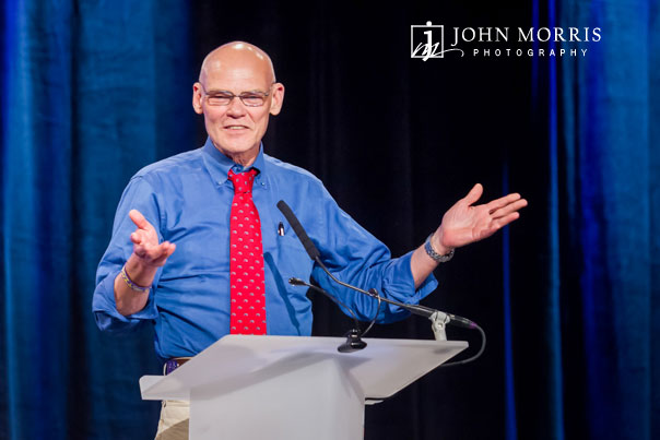 An animated James Carville, on stage addressing a Corporate event crowd