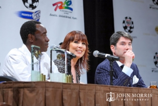 Panel of three celebrities, including Don Cheadle, speaking to a crowd of media during the World Series of Poker in Las Vegas