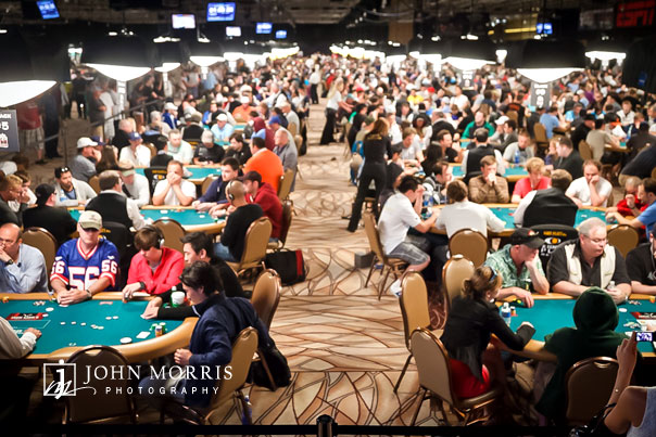 Looking down a row of poker tables filled with players during the event photography World Series of Poker