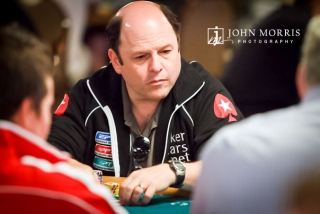 Jason Alexander staring intently at poker table during play at the World Series of Poker in Las Vegas