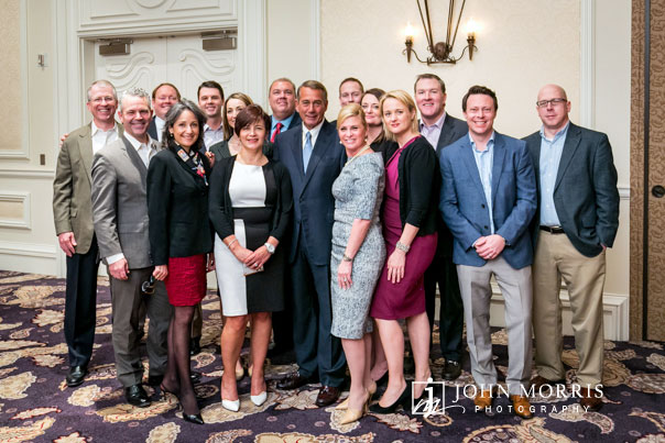 Speaker of the House, John Boehner poses with a group of executives during a conference in San Diego.