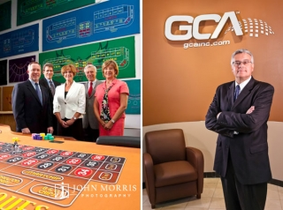 A group of five executives pose for the camera behind a roulette table they designed and a CEO stands proudly in front of signage for a magazine cover story.