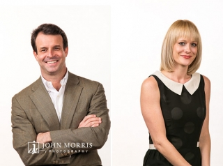 In Studio, fun, candid corporate headshots of a male and female executive on high key, white background