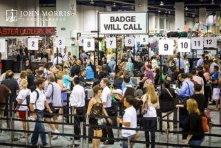 Long lines indicated a popular trade show as attendees wait patiently to receive their badges during a trade show.