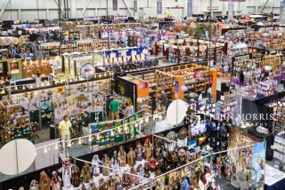 An aerial view of a full show room floor full of booths during a trade show.