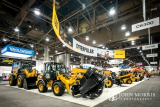 Massive exhibit for Caterpillar construction vehicles inside an exhibit hall for a trade show in Las Vegas.