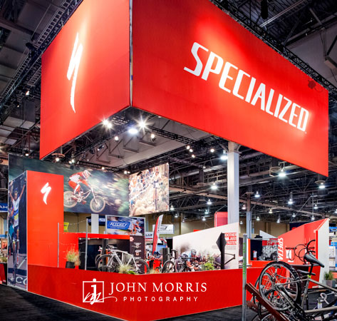 Bright red exhibit booth for a cycling trade show.