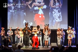 Mickey Mouse closes out the fashion show at private event during a conference.